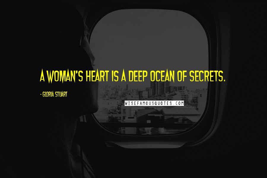 Gloria Stuart Quotes: A woman's heart is a deep ocean of secrets.