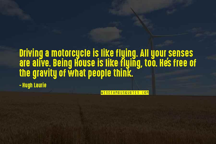 Alive And Free Quotes By Hugh Laurie: Driving a motorcycle is like flying. All your