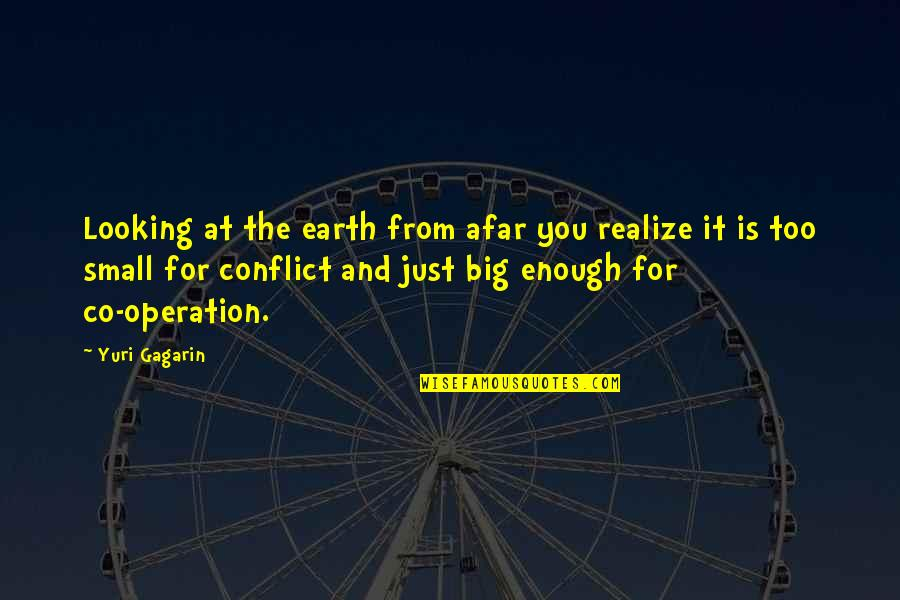 Big And Small Quotes By Yuri Gagarin: Looking at the earth from afar you realize