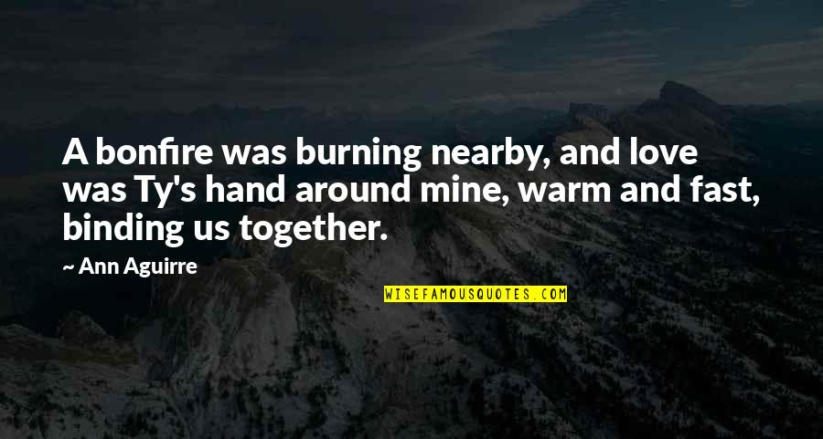 Binding Quotes By Ann Aguirre: A bonfire was burning nearby, and love was