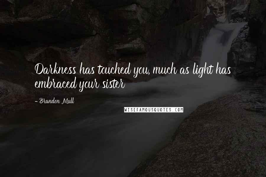 Brandon Mull quotes: Darkness has touched you, much as light has embraced your sister
