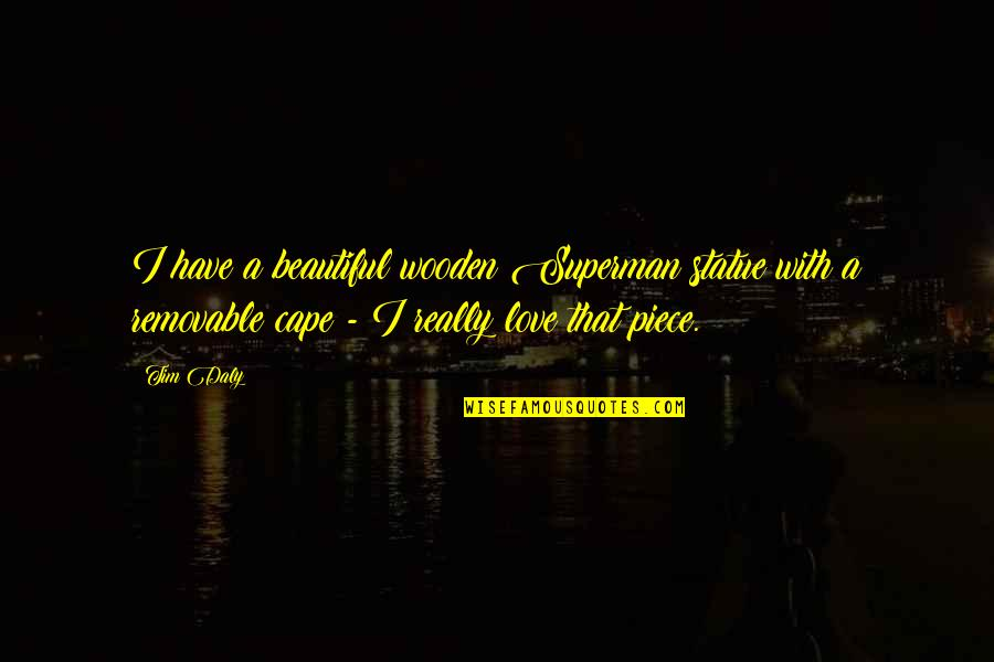 Cape Quotes By Tim Daly: I have a beautiful wooden Superman statue with