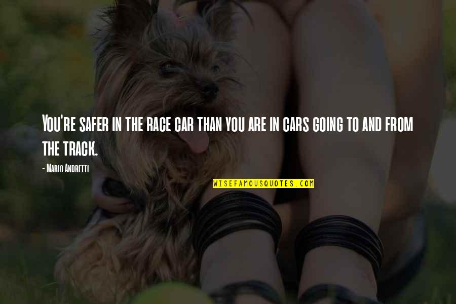 Carax Quotes By Mario Andretti: You're safer in the race car than you