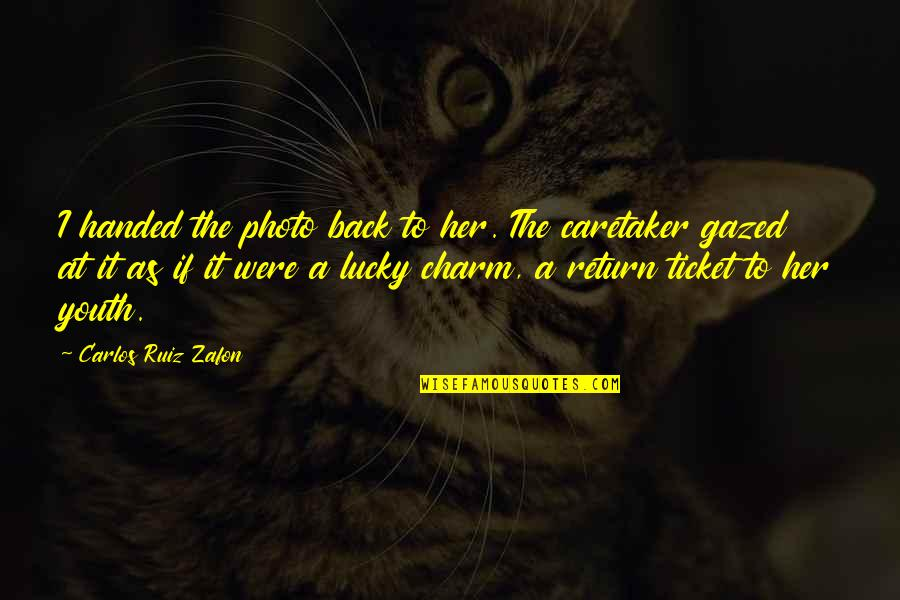 Carlos Ruiz Quotes By Carlos Ruiz Zafon: I handed the photo back to her. The