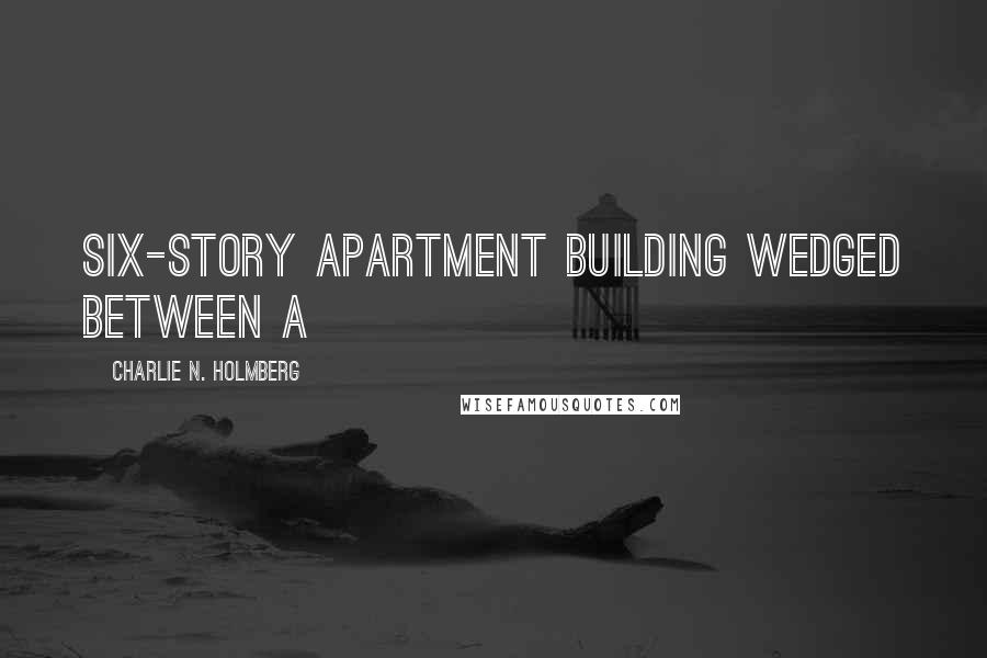 Charlie N. Holmberg quotes: six-story apartment building wedged between a