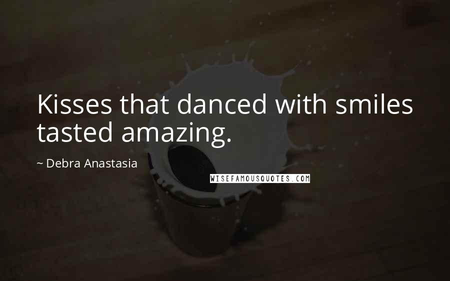 Debra Anastasia quotes: Kisses that danced with smiles tasted amazing.