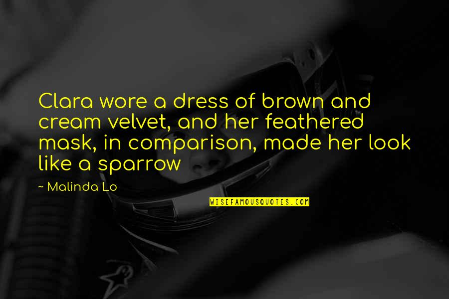 Dress Quotes By Malinda Lo: Clara wore a dress of brown and cream