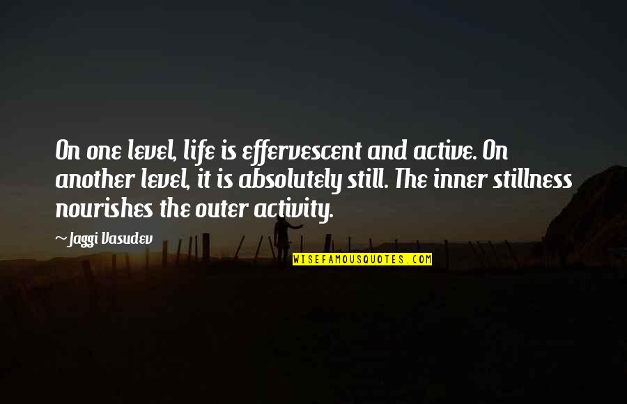 Effervescent Quotes By Jaggi Vasudev: On one level, life is effervescent and active.