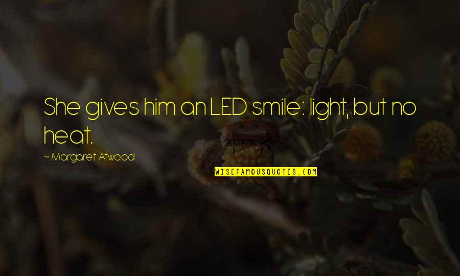 Erudity Quotes By Margaret Atwood: She gives him an LED smile: light, but