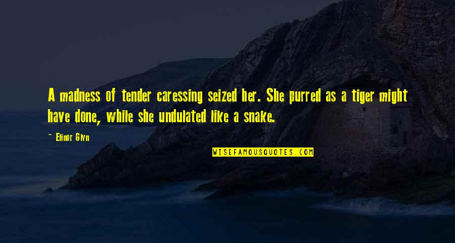 Glyn Quotes By Elinor Glyn: A madness of tender caressing seized her. She