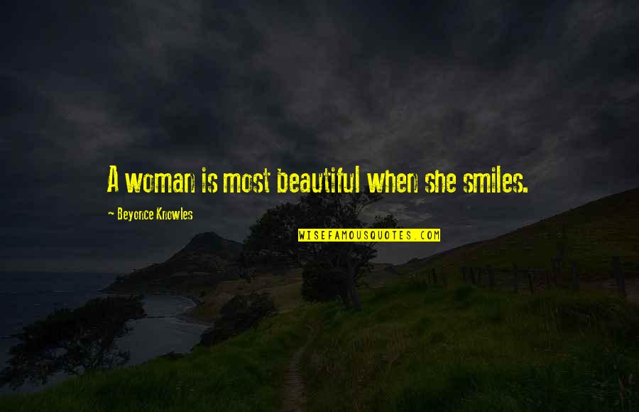 Hilarious Jimmy Fallon Quotes By Beyonce Knowles: A woman is most beautiful when she smiles.