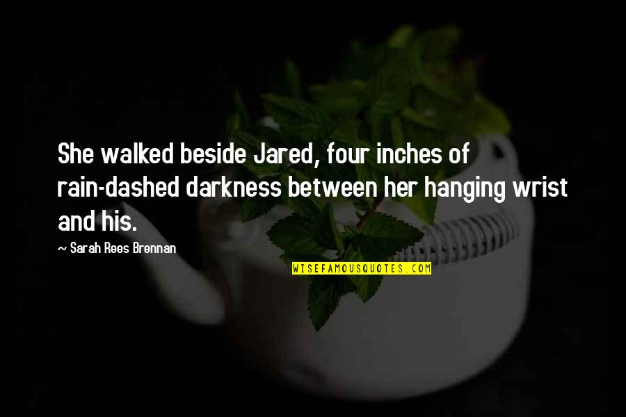 His So Cute Quotes By Sarah Rees Brennan: She walked beside Jared, four inches of rain-dashed