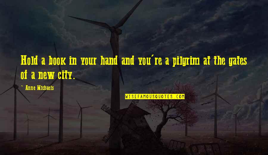 Hold In Your Hand Quotes By Anne Michaels: Hold a book in your hand and you're