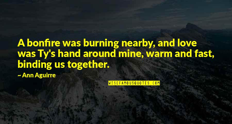 If You Are Mine Quotes By Ann Aguirre: A bonfire was burning nearby, and love was