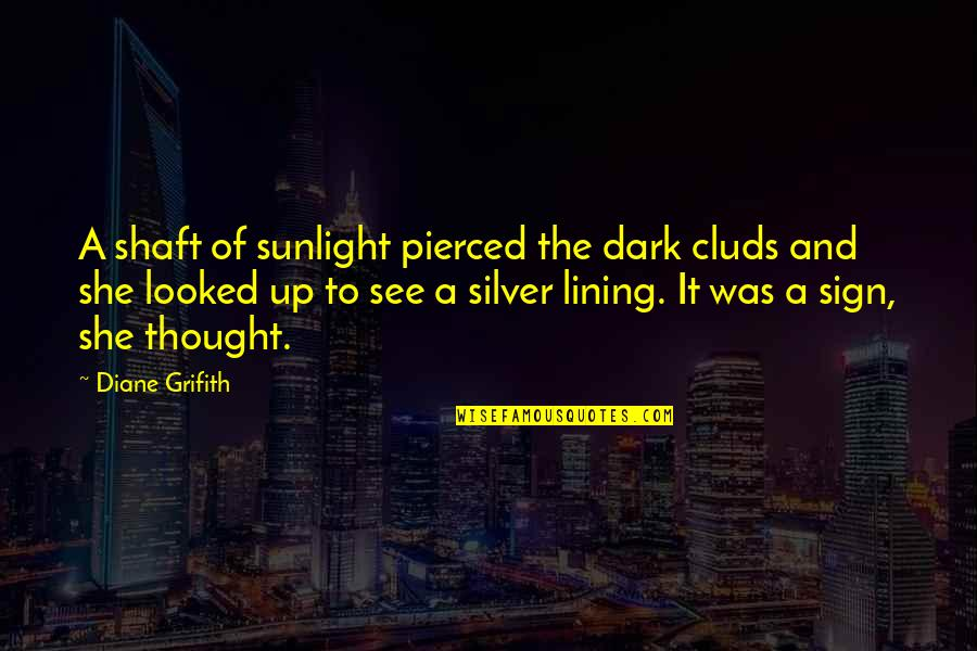 It's A Sign Quotes By Diane Grifith: A shaft of sunlight pierced the dark cluds
