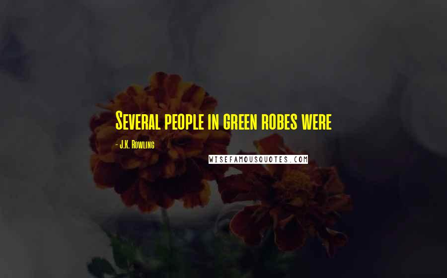 J.K. Rowling quotes: Several people in green robes were