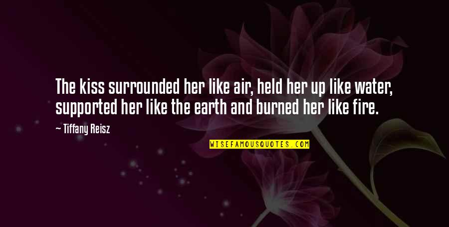 Kiss Her Like Quotes By Tiffany Reisz: The kiss surrounded her like air, held her