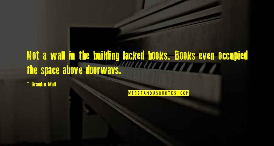Lacked Quotes By Brandon Mull: Not a wall in the building lacked books.