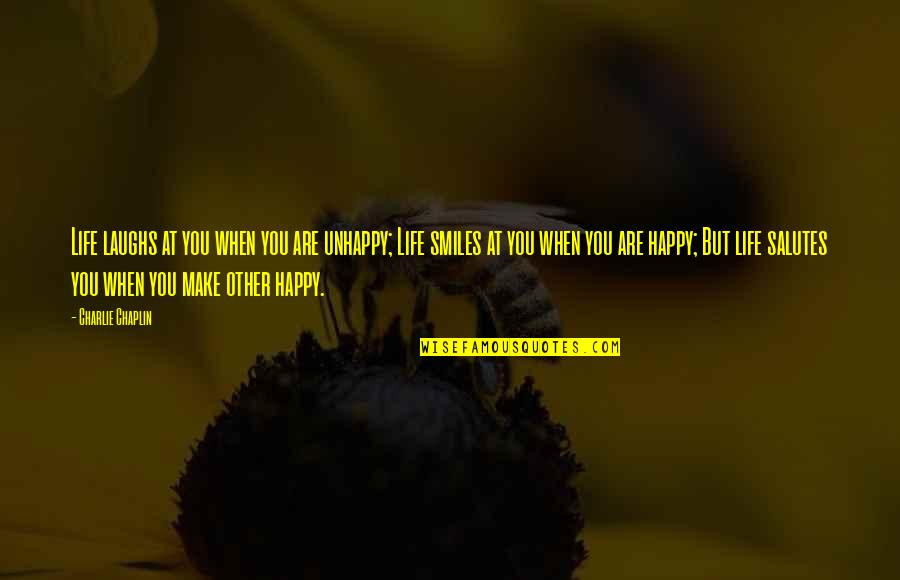 Life's Good When Quotes By Charlie Chaplin: Life laughs at you when you are unhappy;