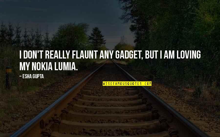 Lumia Quotes By Esha Gupta: I don't really flaunt any gadget, but I