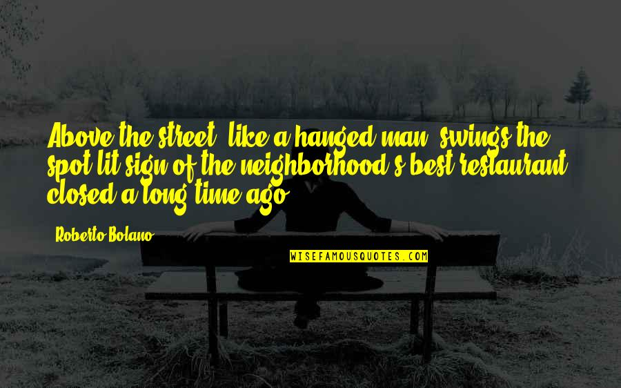 Man Of Quotes By Roberto Bolano: Above the street, like a hanged man, swings