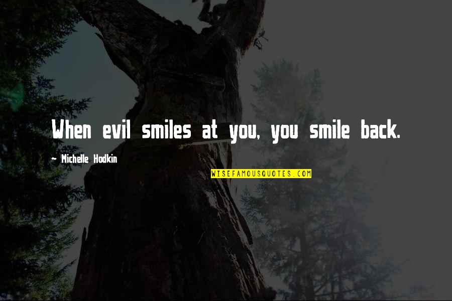 Michelle Hodkin Quotes By Michelle Hodkin: When evil smiles at you, you smile back.