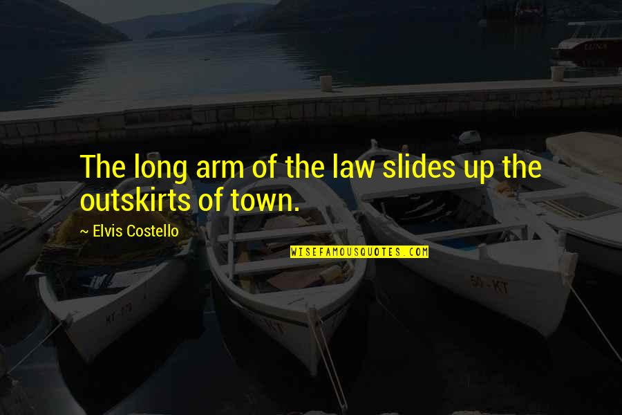 Outskirts Quotes By Elvis Costello: The long arm of the law slides up
