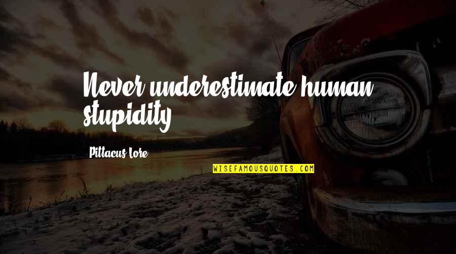Postmenstrual Quotes By Pittacus Lore: Never underestimate human stupidity.