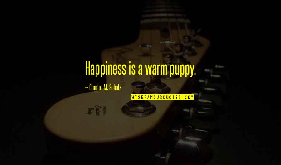 Puppies Quotes By Charles M. Schulz: Happiness is a warm puppy.
