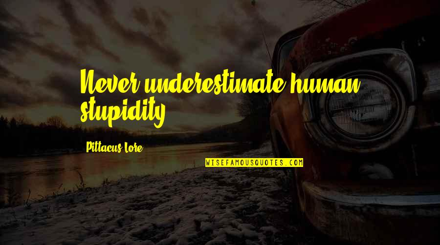 Retirement Banner Quotes By Pittacus Lore: Never underestimate human stupidity.