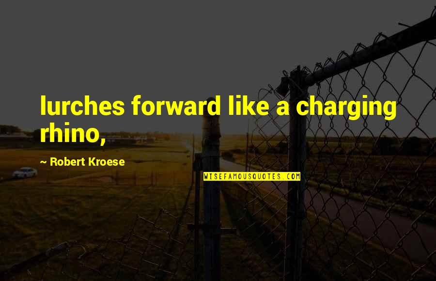 Rhino Quotes By Robert Kroese: lurches forward like a charging rhino,
