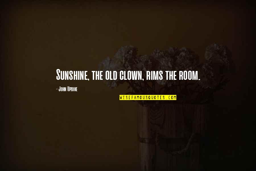 Rims Quotes By John Updike: Sunshine, the old clown, rims the room.