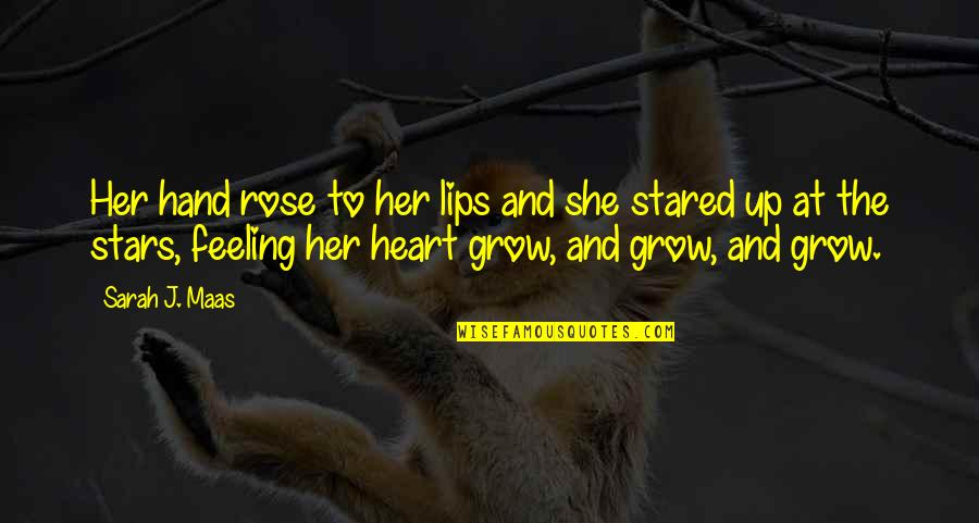 Rose In Hand Quotes By Sarah J. Maas: Her hand rose to her lips and she