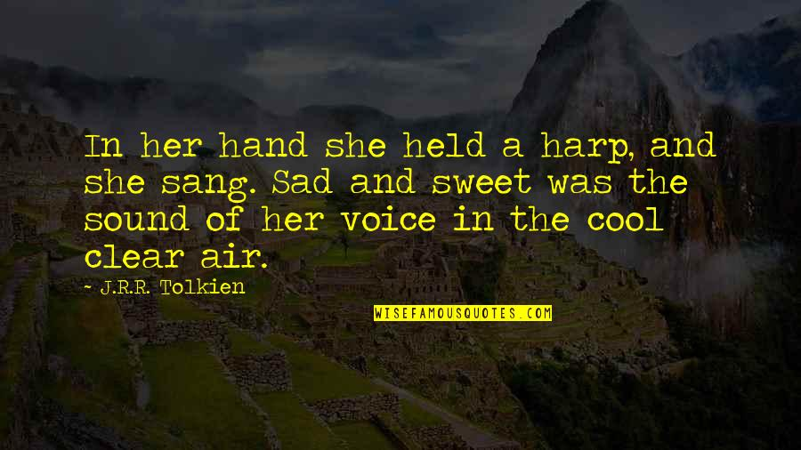 Sad Without Her Quotes By J.R.R. Tolkien: In her hand she held a harp, and