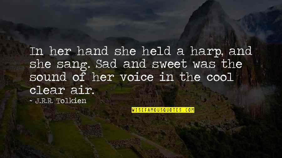 She's Sad Quotes By J.R.R. Tolkien: In her hand she held a harp, and