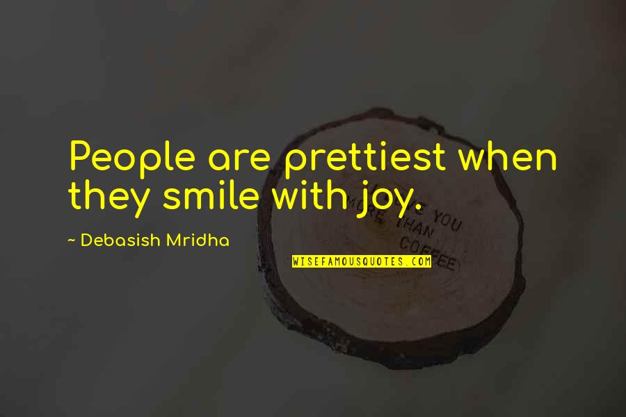 Smile When Your In Love Quotes By Debasish Mridha: People are prettiest when they smile with joy.