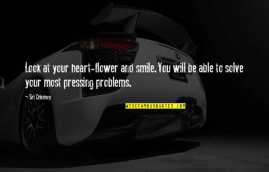 Solve Your Problems Quotes By Sri Chinmoy: Look at your heart-flower and smile.You will be