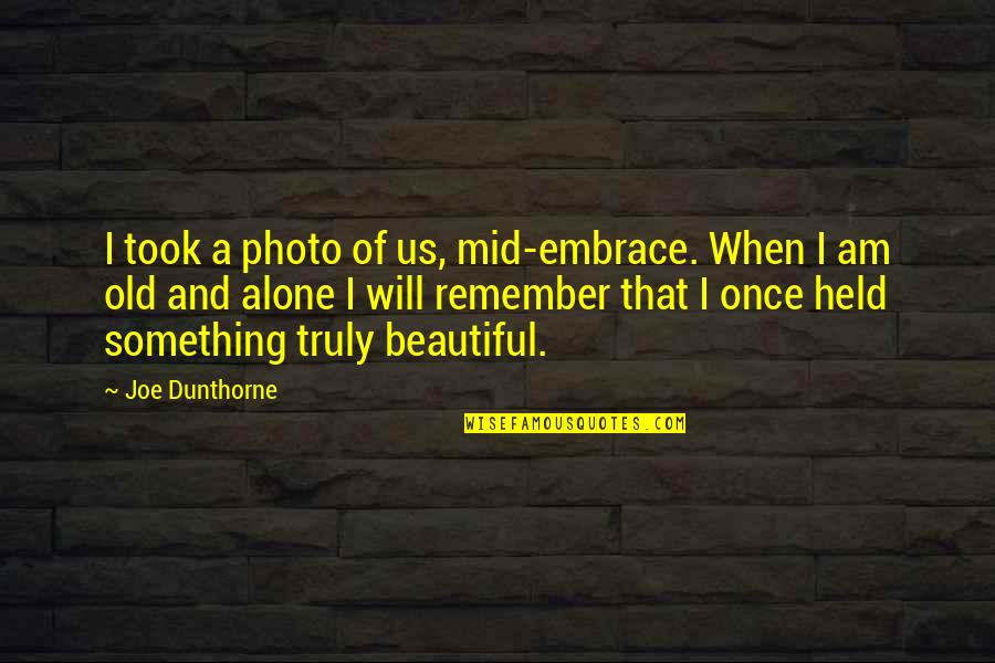 Something Beautiful Quotes By Joe Dunthorne: I took a photo of us, mid-embrace. When