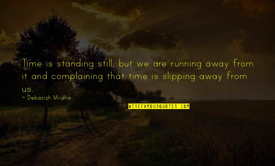 Still Standing Quotes By Debasish Mridha: Time is standing still, but we are running