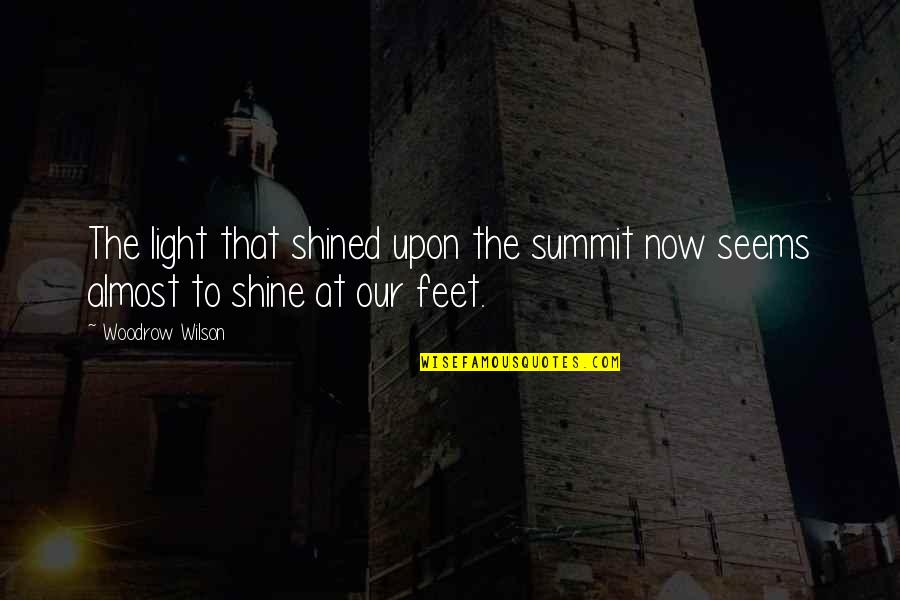 Summit's Quotes By Woodrow Wilson: The light that shined upon the summit now