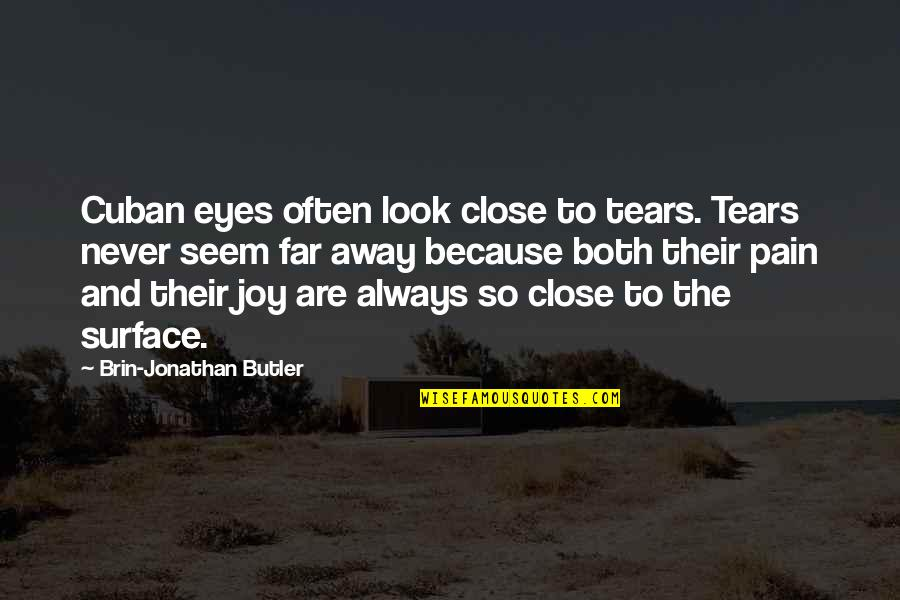 Tears And Pain Quotes By Brin-Jonathan Butler: Cuban eyes often look close to tears. Tears