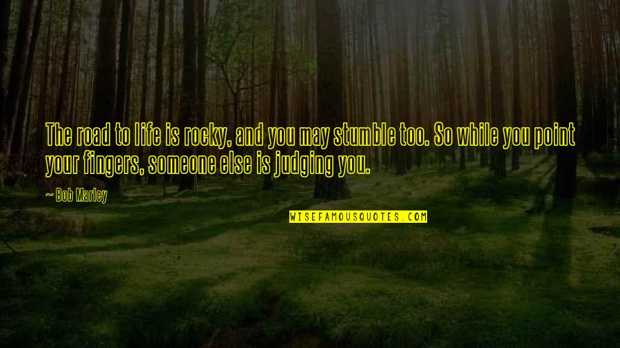 We All Stumble Quotes By Bob Marley: The road to life is rocky, and you