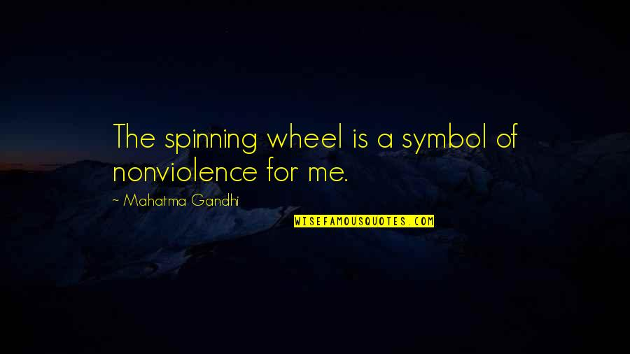 Wheels Quotes By Mahatma Gandhi: The spinning wheel is a symbol of nonviolence