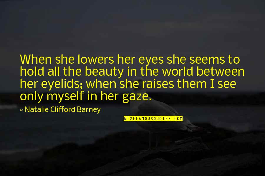 When I Love Quotes By Natalie Clifford Barney: When she lowers her eyes she seems to
