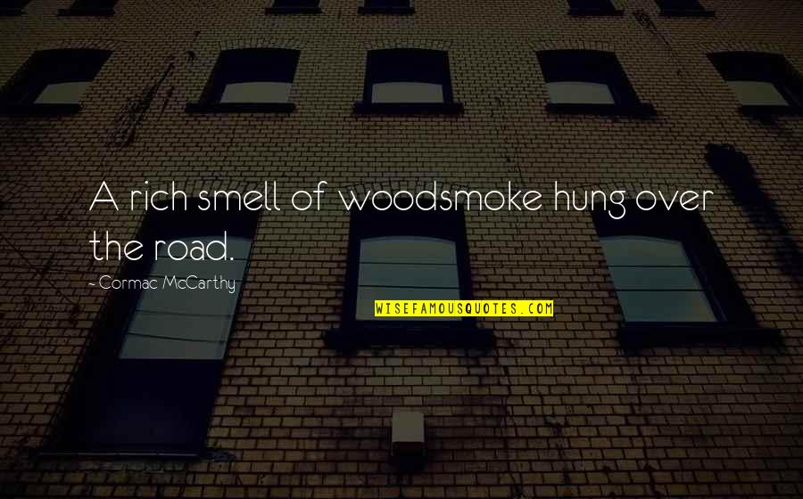 Woodsmoke Quotes By Cormac McCarthy: A rich smell of woodsmoke hung over the